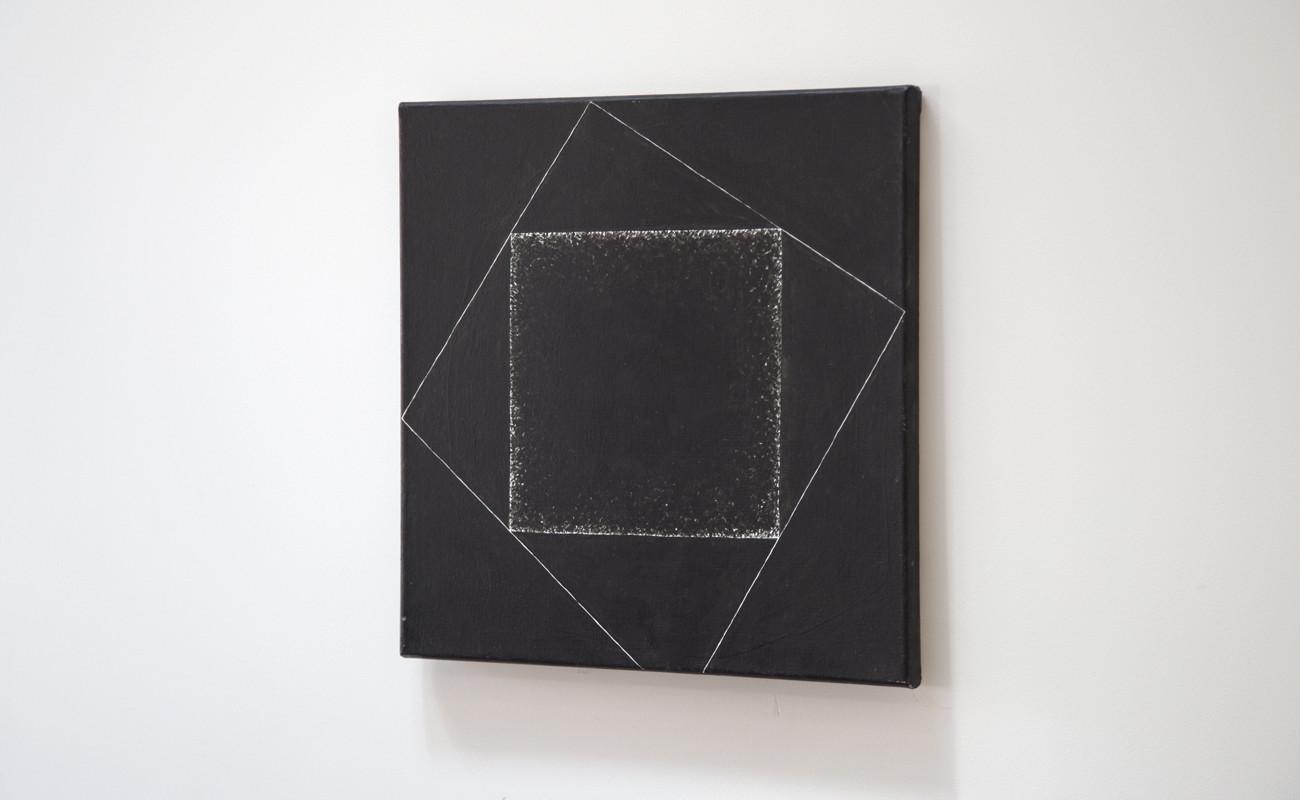 Black square in black square